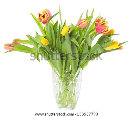 Transparent glass vase with fresh tulips isolated on white background - stock photo