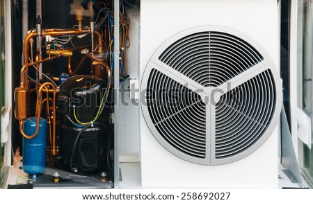 Transparent heating and AC air conditioning unit used in a residential home or business office - stock photo