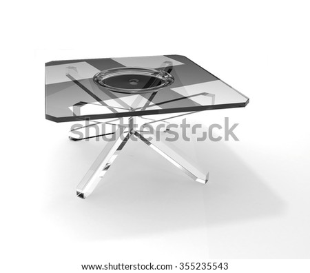 Transparent plate on square glass table - stock photo