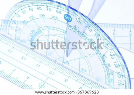 Transparent protractor, ruler and square measuring tools - stock photo