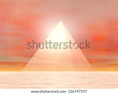 Transparent pyramid made of glass in front of sunset - stock photo