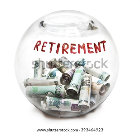Transparent round piggy Bank with money and retirement inscription - stock photo