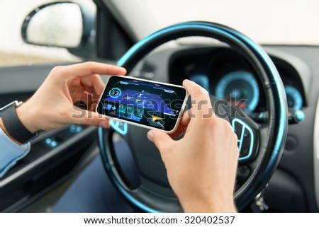 transport, business trip, technology and people concept - close up of male hands with navigation system on smartphone screen in car - stock photo
