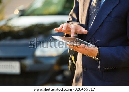 transport, business trip, technology and people concept - close up of young man with tablet pc computer and car outdoors - stock photo