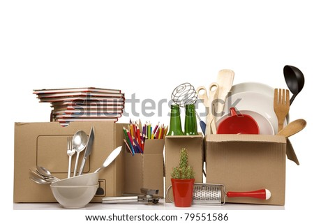 Transport cardboard boxes with books and clothes, relocation concept - stock photo