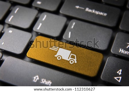 Transport delivery key with truck icon on laptop keyboard. Included clipping path, so you can easily edit it. - stock photo