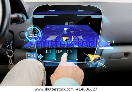 transport, driving, technology, navigation and people concept - close up of male hand using gps navigator application on car computer - stock photo