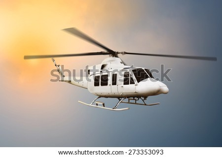 Transport helicopter flying on the sky when sunset - stock photo
