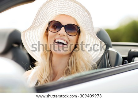 transport, leisure and people concept - face of happy woman in summer hat and sunglasses driving cabriolet car outdoors - stock photo