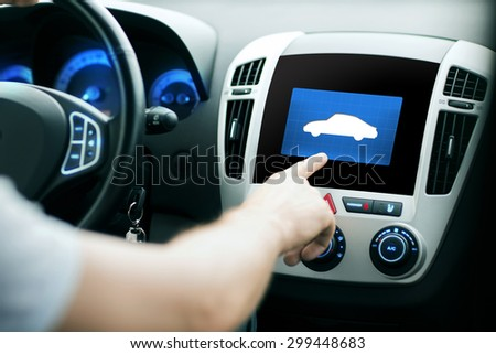 transport, modern technology and people concept - male hand pointing finger to car icon on control panel screen - stock photo