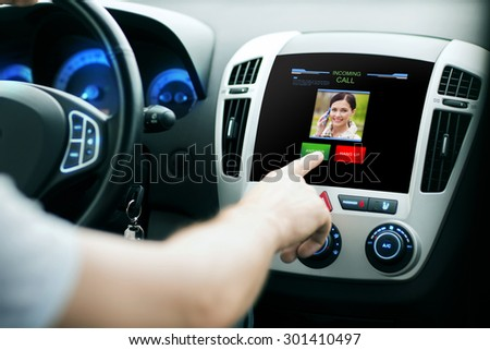 transport, modern technology, communication and people concept - male hand pushing button and receiving video call from woman on car panel screen - stock photo