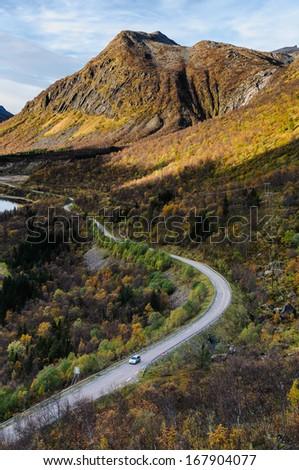 Transport road through beautiful nature of Senja island in autumn - stock photo