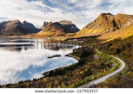 Transport road through beautiful Senja island in autumn - stock photo