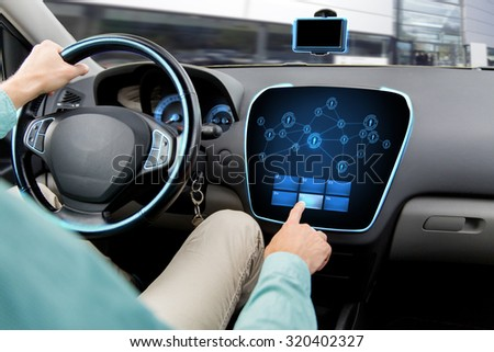 transport, road trip, technology, communication and people concept - close up of man driving car with network icons on board computer - stock photo