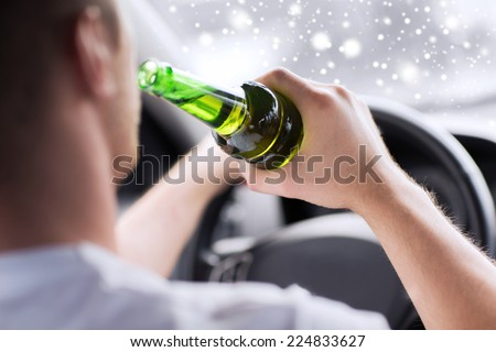transportation, alcohol, vehicle and people concept - close up of man drinking alcohol while driving car - stock photo