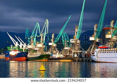 Transportation and logistic background - freight cargo ships and cranes in seaport - stock photo