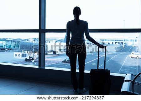 Transportation and travel concept - Woman passenger in the airport - stock photo