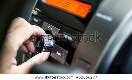 transportation and vehicle concept - man using car audio stereo  - stock photo
