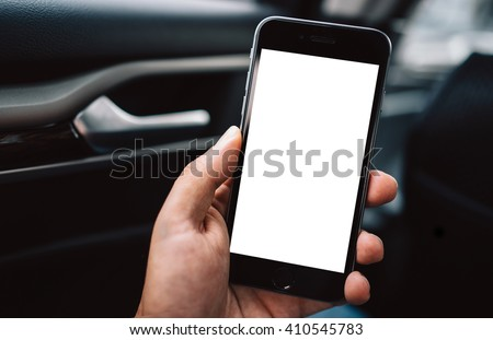 transportation and vehicle concept - man using smart phone in the car. Smart phone with blank screen - stock photo