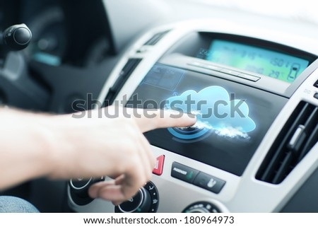 transportation, future technology and vehicle concept - man using car control panel - stock photo