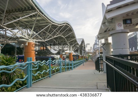 Transportation hub facility/Orlando Transit Center/Buses and trains leaving for morning commute out of this busy transportation center - stock photo
