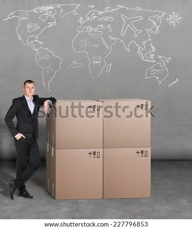 Transportation. Man with boxes and map on background - stock photo