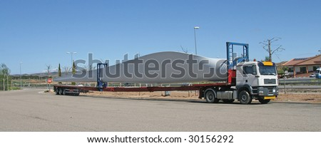 Transportation of a wing of the wind turbine by truck on roads of Spain - stock photo
