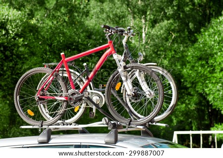 transportation of bicycles on the roof of the car - stock photo