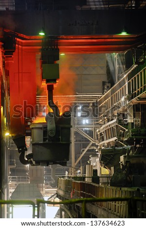 transportation of liquid metal in factory - stock photo