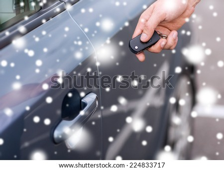 transportation, people, season and ownership concept - close up of man with car key outdoors - stock photo