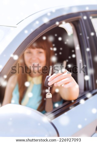 transportation, people, season and ownership concept - close up of smiling woman with car key outdoors - stock photo