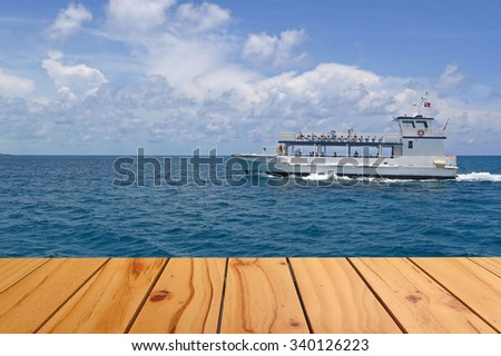 Transportation ship sailing through the sea terrace view - stock photo