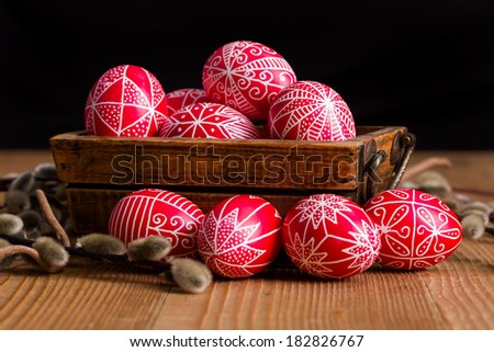 Transylvanian hand written Easter eggs surrounded by willow branches - stock photo