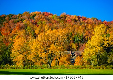 Trapp Family Lodge surrounded by fall foliage, Stowe, Vermont, USA - stock photo