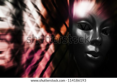 Trapped - Mask behind Steel Fence - stock photo
