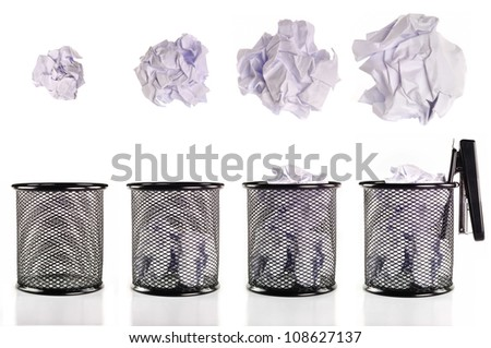 Trash can full of paper And collection of various balls - stock photo