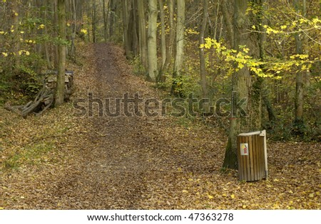 trash can in a forest - stock photo