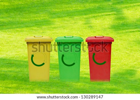 Trash can on the green fields - stock photo