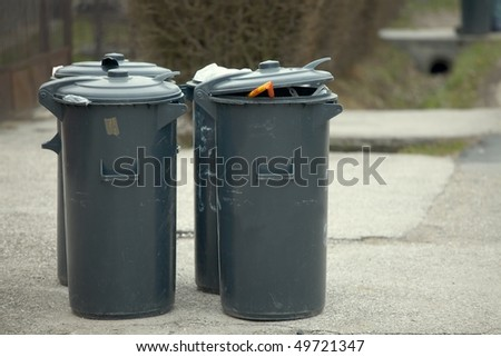 Trash can on the street waiting to be taken away - stock photo
