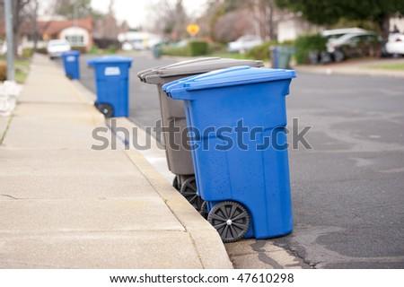 trash day on suburban street - stock photo