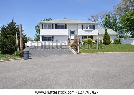 Trash Day Suburban High Ranch House For Sale Sign Residential Neighborhood - stock photo