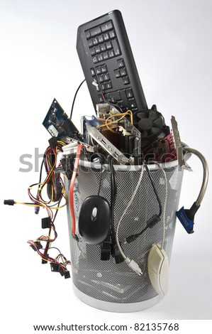 trashcan in grey background with many computer parts - stock photo