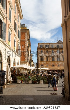 TRASTEVERE IN ROME, ITALY - FEBRUARY 23, 2014: it is a rione of Rome; it maintains its character thanks to its narrow cobbled streets lined by medieval houses, squares, and people walking on the city - stock photo