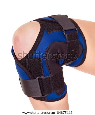 Trauma of knee in brace. Isolated. - stock photo