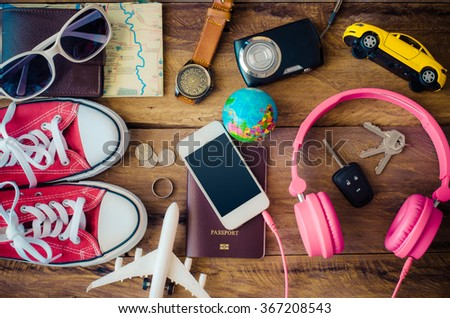 Travel accessories costumes. Passports, luggage, The cost of travel maps prepared for the trip - stock photo