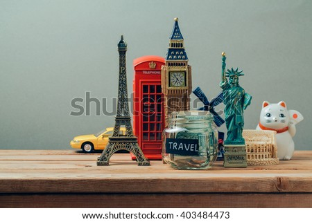Travel and tourism concept with souvenirs from around the world. Planning summer vacation, money budget trip concept. Saving money for vacation. - stock photo