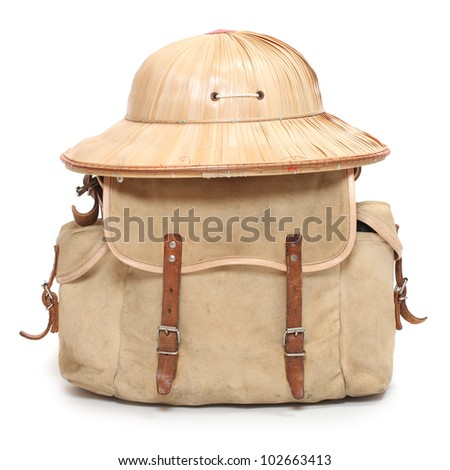 Travel bag and tropical hat. - stock photo