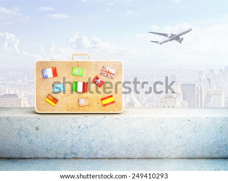 travel bag with many flags, close up - stock photo
