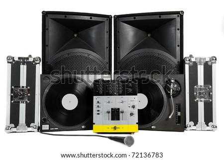 Travel cases, turntables, professional mixing controller, vocal microphone and speakers on white background - stock photo