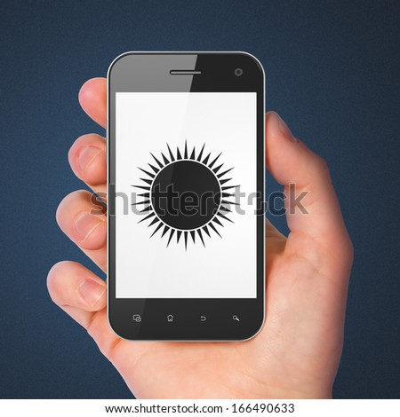 Travel concept: hand holding smartphone with Sun on display. Mobile smart phone on Blue background, 3d render - stock photo